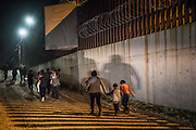 Central American migrant families turn themselves to U.S. Border Patrol to seek asylum following an illegal crossing of the Rio Grande in Hidalgo, Texas, U.S., August 23, 2019.