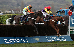 Native River ridden by Richard Johnson (right) jumps the last with Might Bite ridden by Nico de Boinville on their way to victory in the Timico Cheltenham Gold Cup Chase during Gold Cup Day of the 2018 Cheltenham Festival at Cheltenham Racecourse.