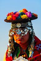 Woman in ornate costume, Jaisalmer Desert Festival, Sam Sand Dunes, near Jaisalmer, Rajasthan.