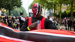 London, August 30th 2015. Revellers enjoy Family Day at the Notting Hill Carnival.