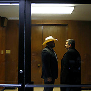 Michael Garza, right, talks with District Attorney's Office Investigator Juan Cano in a small room next to the courtroom as Garza waits for the jury to come back with a verdict on the sixth day of Feit's trial. During deliberations Garza said he had no regrets about the case he presented. It took the jury six hours to come back with a verdict. Nathan Lambrecht/The Monitor
