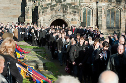 Mourners follow Matt Thorntons  coffin out of All Saints Church Darton Barnsley on Tuesday Morning.. Funeral of Private Matthew Adam Thornton, Territorial Army Soldier with 4th Battalion The Yorkshire Regiment who was killed on the 9th of November 2011 while deployed to Afghanistan with Support Company 1st Battalion the Yorkshire Regiment. .Private Thornton was killed just 6 days after his 28th Birthday and 2 days before Armistice Day. ..29 November 2011  Image © Paul David Drabble