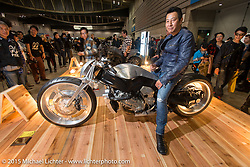 "In the BMW booth with Ken's Factory's ""Ken"" Kenji Nagai with his custom 2015 BMW K1600GTL digger at the Mooneyes Yokohama Hot Rod & Custom Show. Yokohama, Japan. December 6, 2015.  Photography ©2015 Michael Lichter."