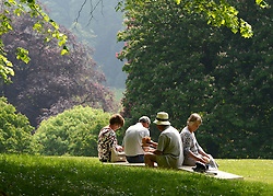 © Licensed to London News Pictures. 24/05/2012. Waddesdon, UK. People enjoy a picnic in the grounds. People enjoy the warm weather amongst an exhibition of contemporary sculpture at Waddesdon Manor, Buckinghamshire, today 24th May 2012. The exhibition is being held by Christie's as part of a private sale. Photo credit : Stephen Simpson/LNP
