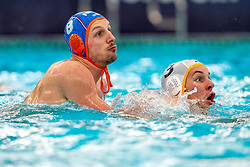 Jesse Nispeling of the Netherlands in action against MiroslavPerkovic of Montenegro during the Olympic qualifying tournament. The Dutch water polo players are on the hunt for a starting ticket for the Olympic Games on February 19, 2021 in Rotterdam