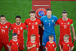 CARDIFF, WALES - Friday, September 6, 2019: Wales players line-up before the UEFA Euro 2020 Qualifying Group E match between Wales and Azerbaijan at the Cardiff City Stadium. L-R: Neil Taylor, Joe Rodon, goalkeeper Wayne Hennessey and captain Gareth Bale. (Pic by Paul Greenwood/Propaganda)