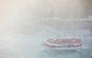 SHOT 10/21/17 3:08:25 PM - The Maid of the Mist is a boat tour of Niagara Falls, starting and ending on the American side, crossing briefly into Ontario during a portion of the trip. (The actual boats used are also named Maid of the Mist, followed by a different Roman numeral in each case.) The boat starts off at a calm part of the Niagara River, near the Rainbow Bridge, and takes its passengers past the American and Bridal Veil Falls, then into the dense mist of spray inside the curve of the Horseshoe Falls, also known as the Canadian Falls. The tour starts and returns on the U.S. side of the river. Buffalo, N.Y. is the second most populous city in the state of New York and is located in Western New York on the eastern shores of Lake Erie and at the head of the Niagara River. By 1900, Buffalo was the 8th largest city in the country, and went on to become a major railroad hub, the largest grain-milling center in the country and the home of the largest steel-making operation in the world. The latter part of the 20th Century saw a reversal of fortunes: by the year 1990 the city had fallen back below its 1900 population levels. (Photo by Marc Piscotty / © 2017)