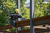 Ironworker assembling the steel framework of a building.
