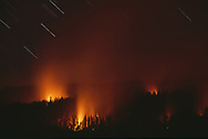 Prescribed fire on the forest floor lights up smoke in night time exposure, mixed-conifer forest, Yosemite N. Park, CA, © David A. Ponton