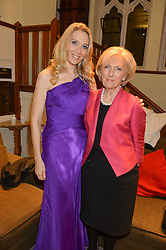 Left to right, NATASHA MARSH and MARY BERRY at the charity Child Bereavement UK's 21st Anniversary Christmas Carol Concert held at Holy Trinity Brompton, London on 10th December 2015.