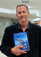 Garden City, New York, U.S. - August 4, 2014 - Dan Hampton, best selling author and retired USAF F-16 legend, discusses his new book Lords of the Sky, a comprehensive popular history of combat aviation, at the Cradle of Aviation Museum in Long Island. Hampton, the author of New York Times best seller Viper Pilot, and the recipient of numerous awards including four Distinguished Flying Crosses with Valor and a Purple Heart, then signed his book about the history of famous military fighter pilots and their planes.
