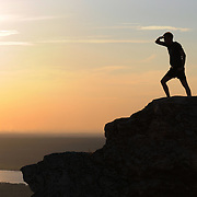 """Man observes Volga river from the highest point of Zhiguli mountains in Russian National Park """"Samara Luka""""."""