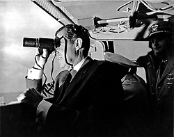 Aboard the USS Hornet - (FILE) -- United States President Richad M. Nixon follows Apollo 11 recovery activities with binoculars aboard the USS Hornet, located 13 miles (20.9215 km) from the spacecraft's splashdown point. The President led the nation in greeting astronauts Neil A. Armstrong, Michael Collins, and Edwin E. Aldrin, Jr., at the successful completion of their historic lunar landing mission on July 24, 1969. Their spacecraft splashed down 900 miles (1448.41 km) southwest of Hawaii at 12:50 p.m. EDT July 24, 1969 eight days after the space pilots were launched by a Saturn V space vehicle from the Kennedy Space Center. Handout Photo by NASA via CNP/ABACAPRESS.COM