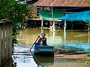 01 NOVEMBER 2017 - PHRA KHAO, NAKHON SO AYUTTHAYA, THAILAND: Woman in boat. Many communities north of Bangkok are flooded because dams have been opened to reliever pressure on reservoirs.      PHOTO BY JACK KURTZ