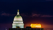 May Supermoon, also known as the Super Flower Moon and Blood Moon, rises before the Wisconsin Statue, topping the Wisconsin State Capitol, 285 feet high. Photo taken May 26, 2021, from Picnic Point.