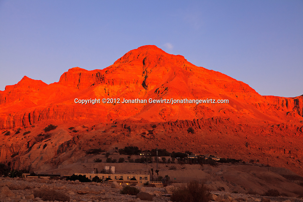 Warm sunlight illuminates the rocky hills behind the Ein Gedi youth hostel, near the Dead Sea oasis of Ein Gedi, at dawn. WATERMARKS WILL NOT APPEAR ON PRINTS OR LICENSED IMAGES.