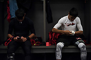 Eli Olvera and Kevin Benavides of the Iraan High School football team get ready in the locker room before the state championship game at AT&T Stadium in Arlington, Texas on December 15, 2016. (Cooper Neill for The New York Times)
