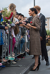 The Duchess of Sussex is given a brooch by Alexandra MacKay during a visit to the UK war memorial and Pukeahu National War Memorial Park, in Wellington, on day one of the royal couple's tour of New Zealand.