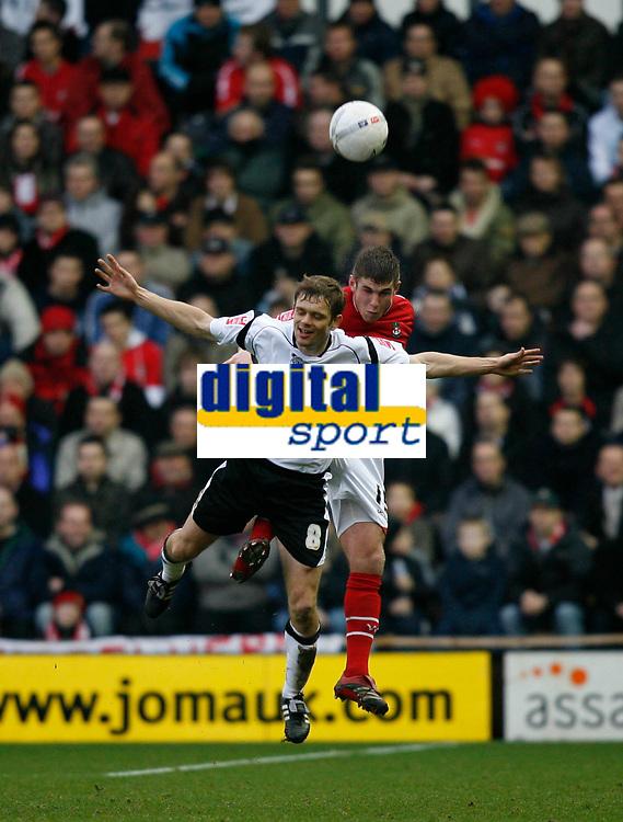 Morten Bisgaard of Derby County (white) loses an aeriel challange against a Wrexham defender
