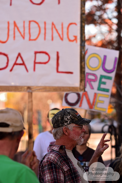 """11/15/2016, Boulder, Colorado, Pearl Street Mall County Courthouse and Wells Fargo Branch.  These were two peaceful protests with music and speeches to rally people to say no to the Dakota Access pipeline (#NoDAPL).  From www.nodaplsolidarity.org website: <br /> <br /> The """"Dakota Acces"""" Pipeline (DAPL) is a $3.8B, 1,100 mile fracked-oil pipeline currently under construction from the Bakken shale fields of North Dakota to Peoria, Illinois. DAPL is slated to cross Lakota Treaty Territory at the Standing Rock Sioux Reservation where it would be laid underneath the Missouri River, the longest river on the continent.<br /> <br /> Construction of the DAPL would engender a renewed fracking-frenzy in the Bakken shale region, as well as endanger a source of fresh water for the Standing Rock Sioux and 8 million people living downstream. DAPL would also impact many sites that are sacred to the Standing Rock Sioux and other indigenous nations.<br /> <br /> The DAPL is a massive project being organized by a shady group of the world's largest fossil-fuel companies and banks. They have offices in cities around the world. Putting direct, nonviolent pressure on the corporations building and funding this project is critical for supporting frontline resistance to DAPL.  <br /> <br /> Wells Fargo is listed as a """"secondary target"""" on the website."""