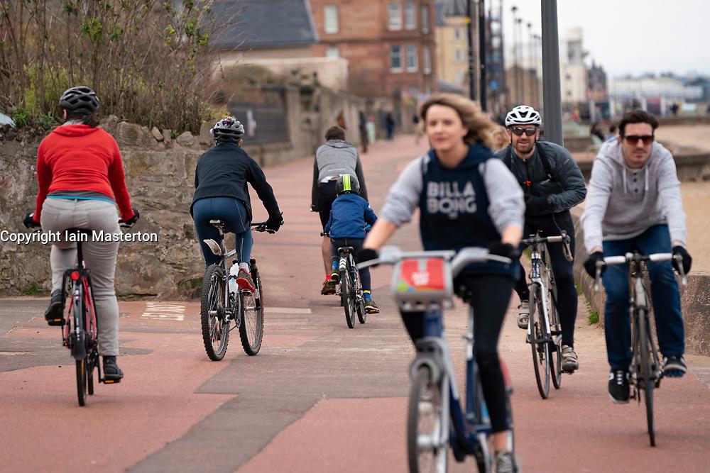 Portobello, Edinburgh, Scotland, UK. 5 April, 2020.  Images of Portobello promenade on the second Sunday of the coronavirus lockdown in the UK. Many cyclists on the promenade.