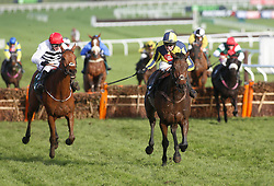 Melrose Boy and Kieron Edgar (right) head away from the last flight before going on to win The Velcourt Conditional Jockeys' Handicap Hurdle Race run during day three of the November Meeting at Cheltenham Racecourse.