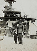 soldier father posing with daughter on the Mikasa battle ship Yokosuka Japan 1940s