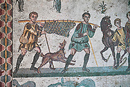 Hunters with a wild boar. Roman mosaic floor of the Room of The Small Hunt, no 25 - Roman mosaics at the Villa Romana del Casale ,  circa the first quarter of the 4th century AD. Sicily, Italy. A UNESCO World Heritage Site. .<br /> <br /> If you prefer to buy from our ALAMY PHOTO LIBRARY  Collection visit : https://www.alamy.com/portfolio/paul-williams-funkystock/villaromanadelcasale.html<br /> Visit our ROMAN MOSAICS  PHOTO COLLECTIONS for more photos to buy as buy as wall art prints https://funkystock.photoshelter.com/gallery/Roman-Mosaics-Roman-Mosaic-Pictures-Photos-and-Images-Fotos/G00008dLtP71H_yc/C0000q_tZnliJD08
