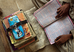 A student reads at the school that Mukhtar Mai created, Meerwala, Pakistan, April 29, 2005. Mai, 33, went against the Pakistani tradition of committing suicide when she brought charges against the men who gang raped her nearly three years ago. With money from the ruling she opened two schools, one for girls, the other for boys, citing that education is the only thing that will stop such acts from happening.