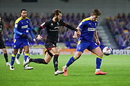 AFC Wimbledon midfielder Alex Woodyard (4) dribbling during the EFL Sky Bet League 1 match between AFC Wimbledon and Lincoln City at Plough Lane, London, United Kingdom on 2 January 2021.