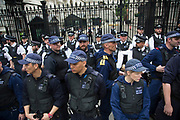 London, UK. Wednesday 27th May 2015. Police guarding Downing Street as students demonstrate in Westminster against Tory Party cuts. The protest was focussed on a number of subjects including spending cuts but generally was a mark of displeasure and concern as to what the Conservatives will do while in power.