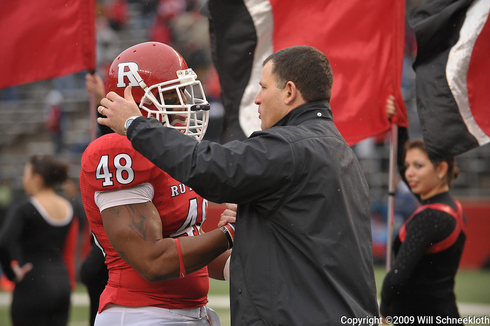 Dec 5, 2009; Piscataway, NJ, USA; Rutgers head coach Greg Schiano shakes hands with defensive tackle Blair Bines during the senior ceremony before first half NCAA Big East college football action between Rutgers and West Virginia at Rutgers Stadium.