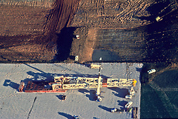 Stock photo of an aerial view of an on-shore oil and gas drilling rig being setup.