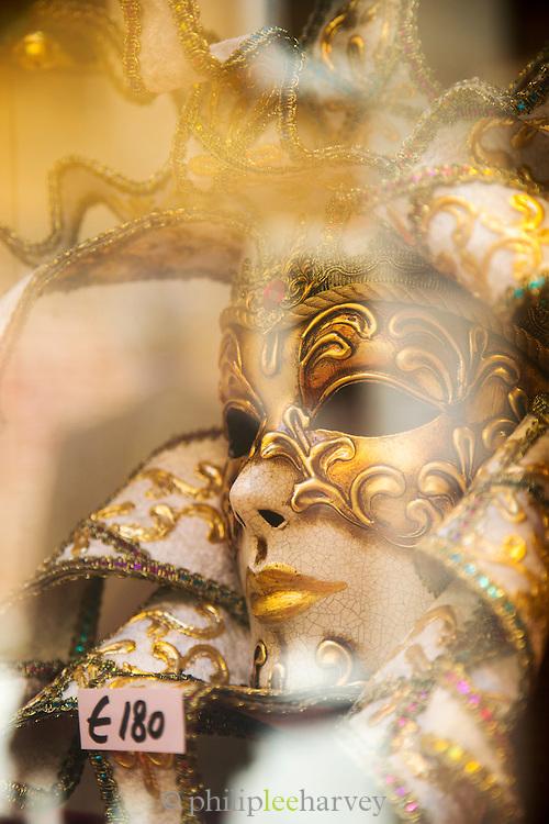 Venetian Masquerade mask in a shop window in Venice. Italy, Europe