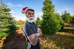 Dougie Duff, of Dufftrees, out at the big xmas  trees, Christmas Tree Farm Wester Auchentroig Farm, Nr Buchlyvie. The tree farm is donating trees for the Highland villages who've had their free trees taken off them this year.