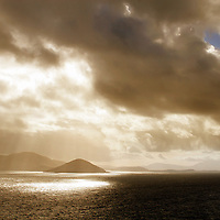 Typical Irish Landscape with dramatic Sunbeam with Stormy Sky Over Ballinskelligs Bay after Rain Shower, Southwest Kerry, County Kerry Iveragh Peninsula Ireland / bs016
