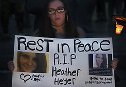 August 13, 2017 - Washington, DC, U.S - CAROL PETRUCCI of Silver Spring MD participates in  ''Charlottesville Solidarity Action'' holds a candlelight vigil in front of the White House in Washington, D.C. quietly singing during the peaceful rally.   Protests took place in many states following the violence and tragedy in Charlottesville VA on Saturday during a White Supremacist ''Unite the Right'' rally resulting in deaths and injuries. (Credit Image: © Carol Guzy via ZUMA Wire)