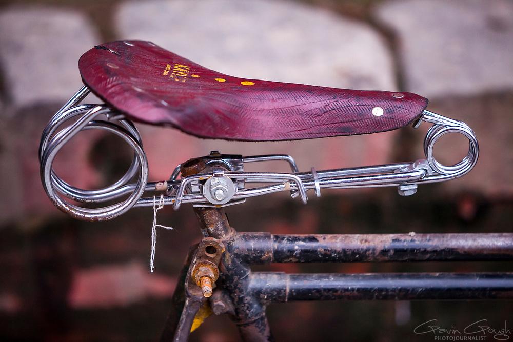 Close up of an old red bicycle saddle, Durbar Square, Kathmandu, Nepal