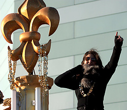 09 February 2010. New Orleans, Louisiana, USA. <br /> Rita Benson Leblanc, vice president and part owner of the Saints, daughter of Tom Benson, leads the team as Saints Mania captures New Orleans like no other parade. The New Orleans Saints victorous NFL football team makes its way from the Superdome through the city. Drew Brees and the crew make their way through screaming fans. The team salutes the massed crowds along the victory parade route in downtown New Orleans following the team's stunning victory over the Indianapolis Colts for Superbowl 44. <br /> Photo ©; Charlie Varley. Varleypix.com