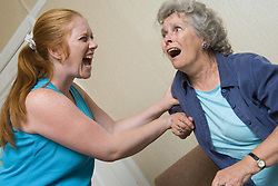 Young woman verbally abusing older person,