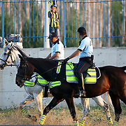 Security police with horses during the tour around the stadium. Turkish Super Cup 2012 soccer derby match Galatasaray between Fenerbahce at the Kazim Karabekir stadium in Erzurum Turkey on Sunday, 12 August 2012. Photo by TURKPIX