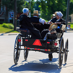 Intercourse, PA - June 19, 2016: An Amish buggy in summer on the main village street in Lancaster County, PA.