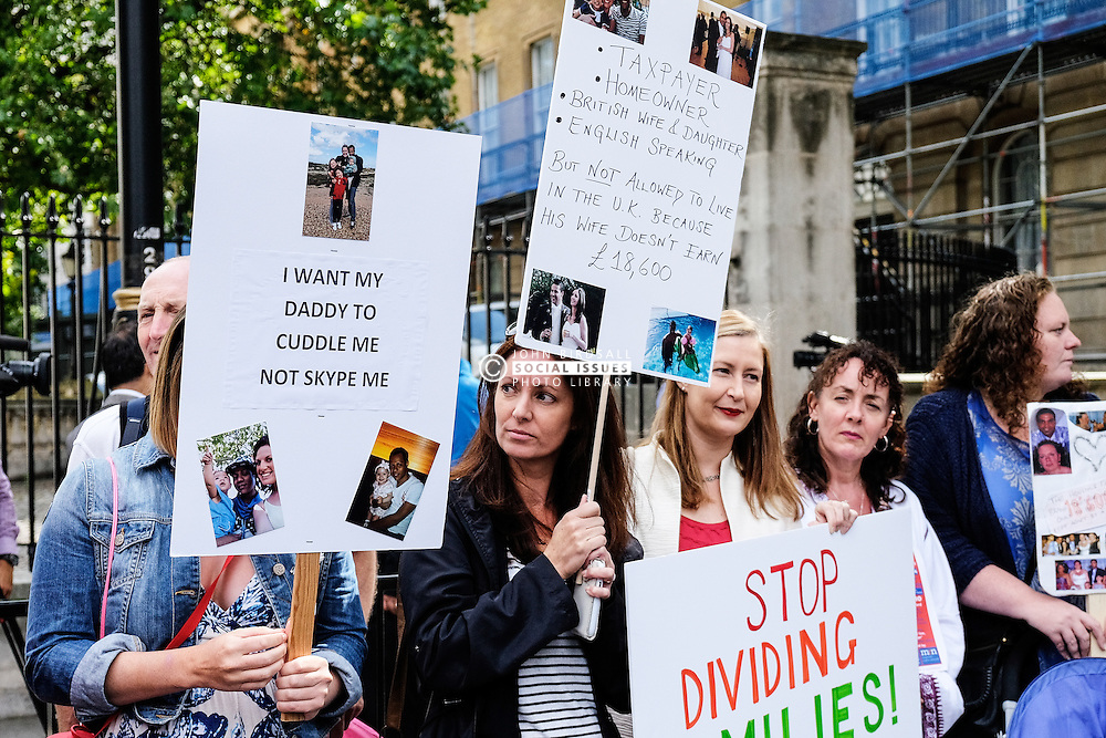 Demonstrators protesting against government rules on family migration. August 2014 UK