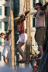 Trafalgar Square, London, March 25th 2016. Thousands of Londoners an tourists in Trafalgar Square are treated to The Passion of Jesus, a re-enactment of the events leading up to the crucifixion and resurrection of Jesus Christ. PICTURED: Jesus on the cross between the two criminals. <br /> ©Paul Davey<br /> FOR LICENCING CONTACT: Paul Davey +44 (0) 7966 016 296 paul@pauldaveycreative.co.uk