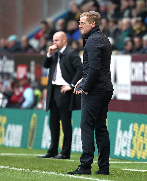 Swansea City manager Garry Monk looks less than impressed during the first half<br /> <br /> Photographer Rich Linley/CameraSport<br /> <br /> Football - Barclays Premiership - Burnley v Swansea City - Friday 27th February 2015 - Turf Moor - Burnley<br /> <br /> © CameraSport - 43 Linden Ave. Countesthorpe. Leicester. England. LE8 5PG - Tel: +44 (0) 116 277 4147 - admin@camerasport.com - www.camerasport.com