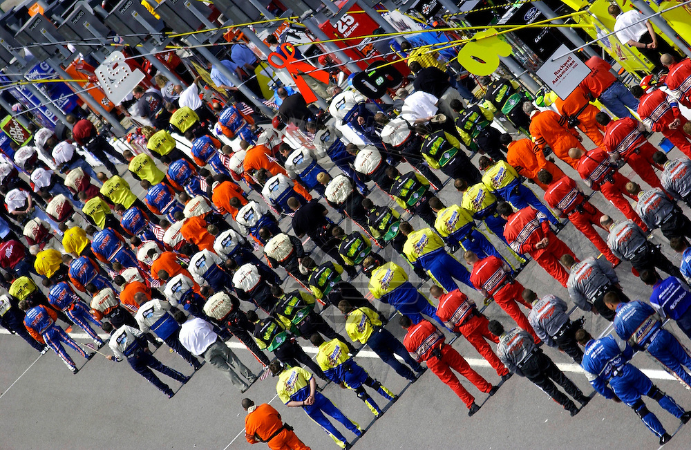 Crews stand in line before introductions at the Charter Pipeline 250 NASCAR Busch Grand National race at the Gateway International Speedway in Madison, Illinois.