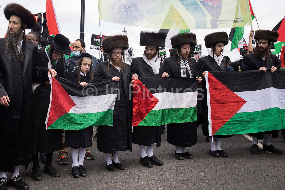 Ultra-Orthodox anti-Zionist Haredi Jews from Neturei Karta UK stand holding Palestinian flags during the National Demonstration for Palestine on 22nd May 2021 in London, United Kingdom. The demonstration was organised by pro-Palestinian solidarity groups in protest against Israels recent attacks on Gaza, its incursions at the Al-Aqsa mosque and its attempts to forcibly displace Palestinian families from the Sheikh Jarrah neighbourhood of East Jerusalem.