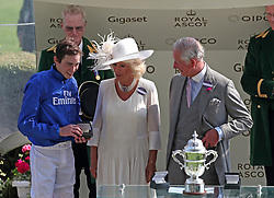 The Duchess of Cornwall and Prince of Wales present a trophy to James Doyle (right) for winning St James's Palace Stakes during day one of Royal Ascot at Ascot Racecourse.