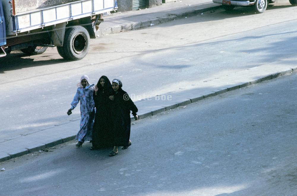3 Muslim women walking together