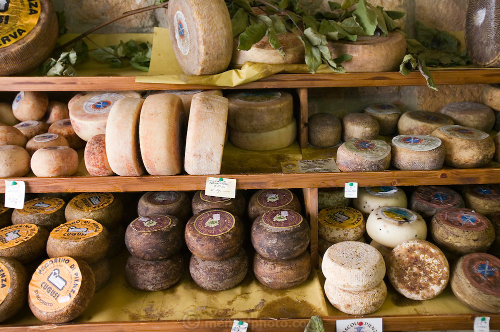 Cheese in a cheese shop in Pienza, Italy. (between Rome and Florence, near Montepulciano).